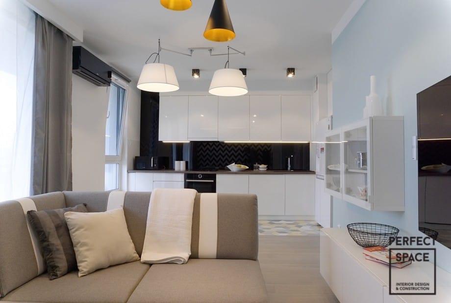Male-mieszkanie-mozna-optycznie-powiekszyc-urzadzajac-wnetrze-meblami-na-wysoki-polysk Duży problem? Urządzanie wnętrz o małym metrażu