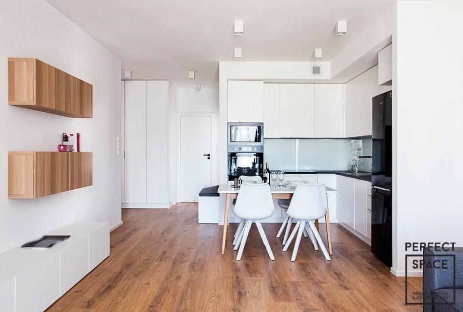 Wykonczone-mieszkanie-pod-klucz-w-nowej-inwestycji-deweloperskiej-w-Warszawie-salon Wpływ pracowników z Ukrainy na nowe inwestycje deweloperskie