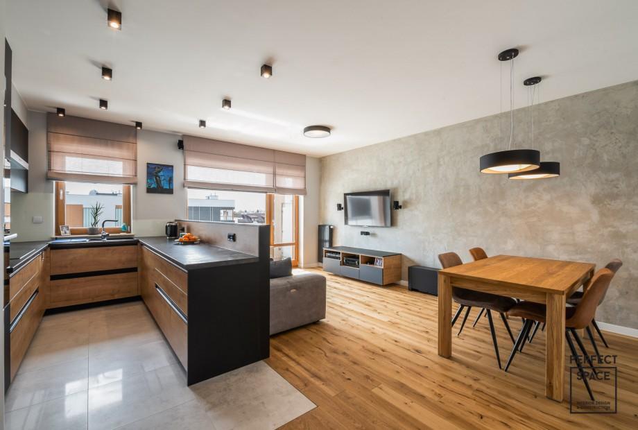 Wnetrze-urzadzone-w-surowym-stylu-gdzie-dominuje-czerń-beton-i-drewno Umiar w urządzaniu wnętrz, czyli prostota nie jest zła